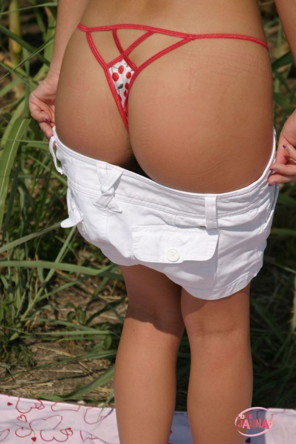 Jannah pulls down her shorts to show off her cute little g string